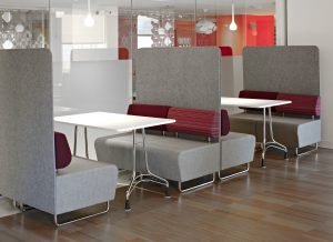 KI Hub with Screens and Enlite Tables in Cafeteria Setting