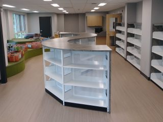 Low bookcases that curve in a library setting